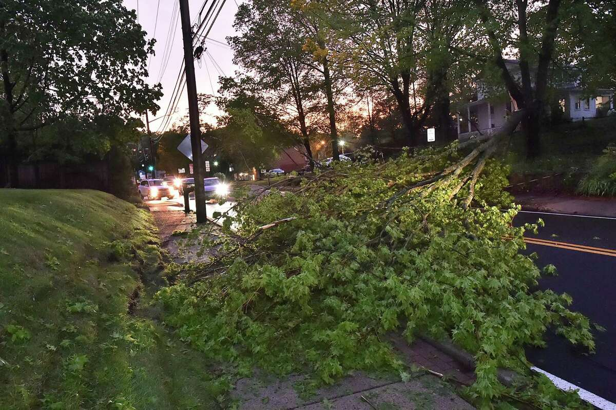 Trees and power lines knocked down by the thunderstorm blocked roads in Hamden May 15, 2018.