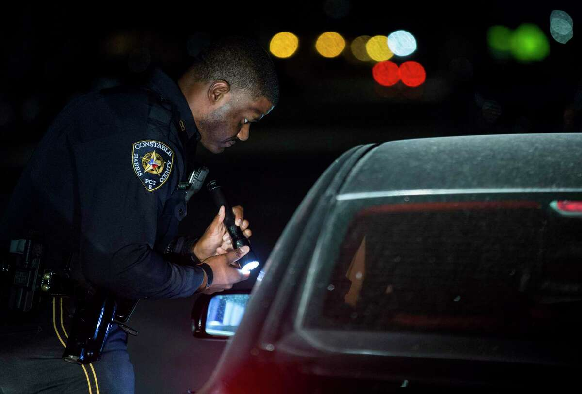 Harris County Precinct 8 deputy constable Jonathan Tolivertalks to a motorist during a traffic stop on the Gulf Freeway Service Road Saturday, Sept. 1, 2018, in Houston.