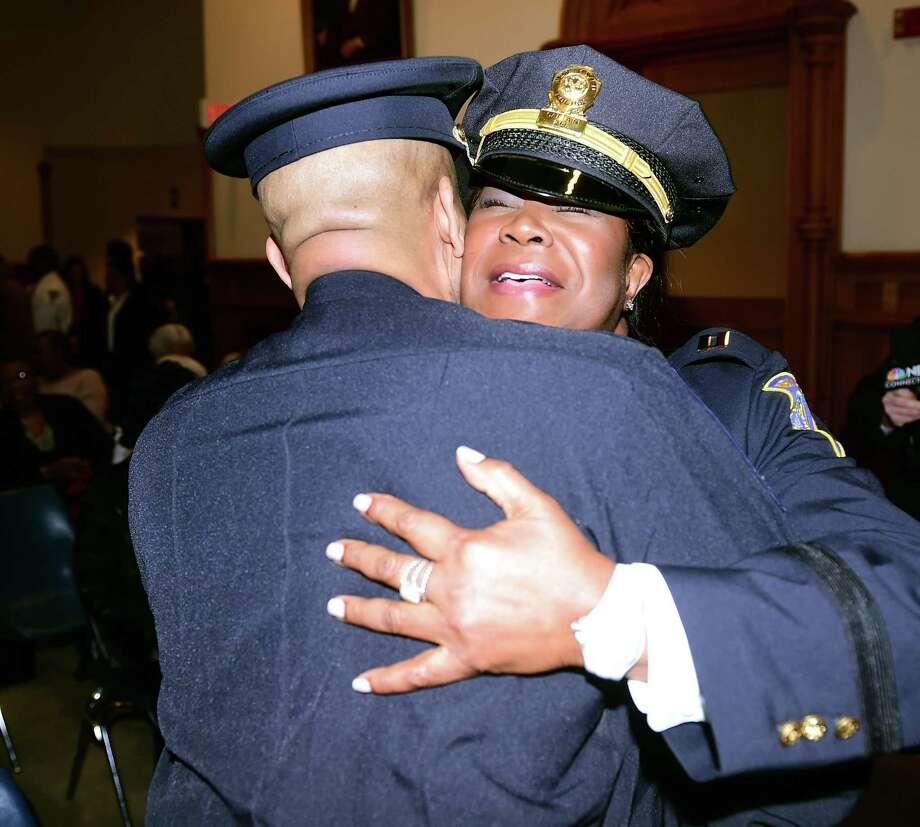 New Haven police Capt. Patricia Helliger, right, hugs Central Connecticut State University Police Chief Greg Sneed before her promotion ceremony at City Hall in New Haven in 2016. Photo: Hearst Connecticut Media File