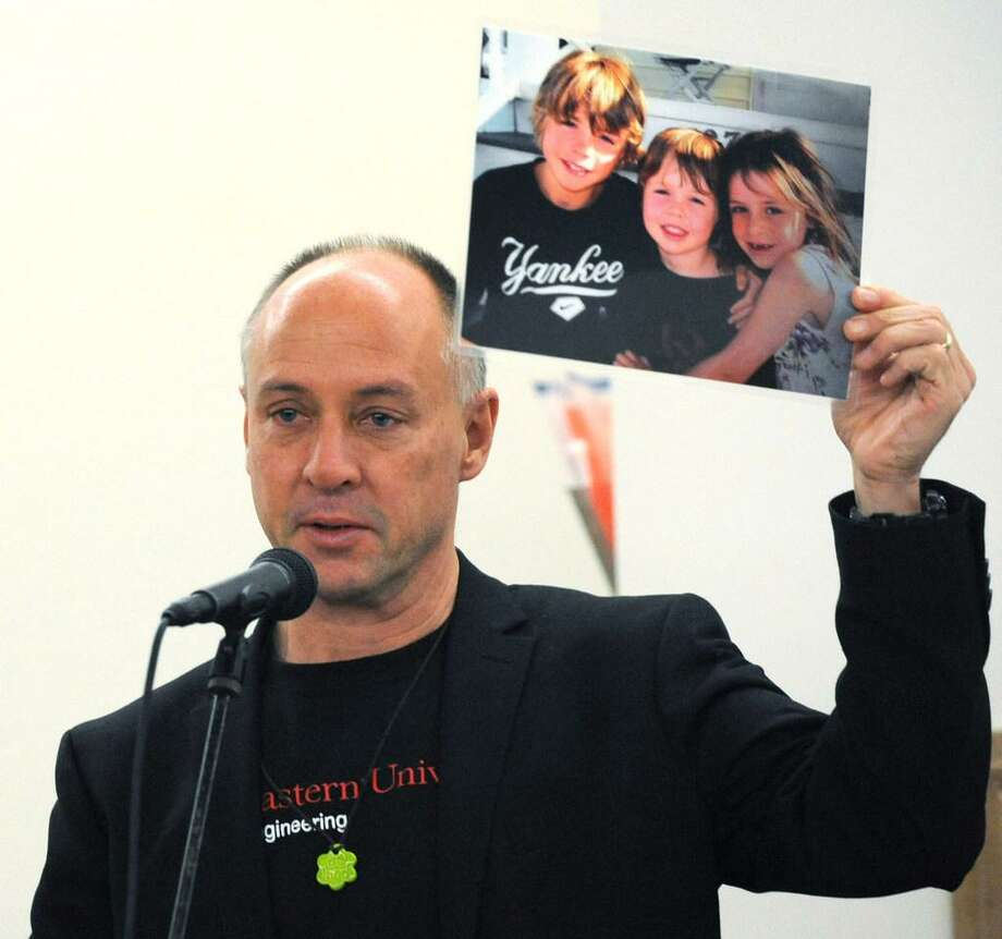 Sandy Hook Promise founder Mark Barden, who lost his son Daniel at Sandy Hook, holds up a photo of his children as the Wilton Quaker Meeting of the Religious Society of Friends hosts a Remembrance Vigil for All Victims of Gun Violence Saturday, December 8, 2018, at their facility in Wilton, Conn. The event was associated with the 6th Annual National Vigil being held in Washington, D.C. Wednesday. Photo: File Photo