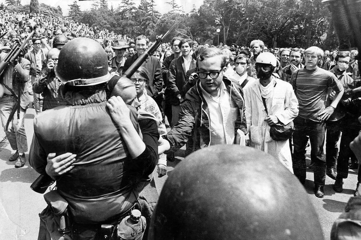 A protester hugs a National Guardsman during a standoff over the college takeover of People's Park, May 21, 1969 Photo ran 05/22/1969, P. 1