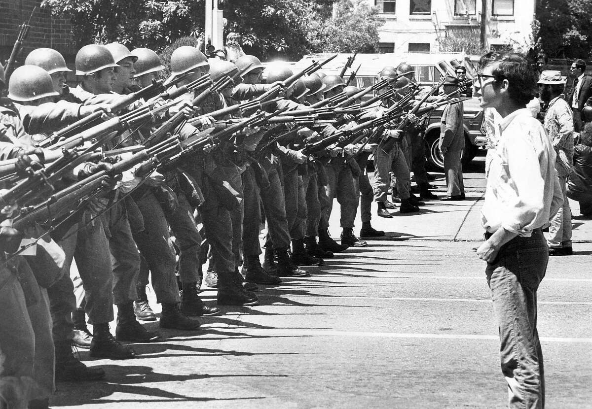 People's Park demonstrators walk up to the National Guardsmen at Telegraph and Durant in Berkeley May 16, 1969. The Guard would soon move up the street to clear protesters. Photo ran 05/14/1989, p.7 This World