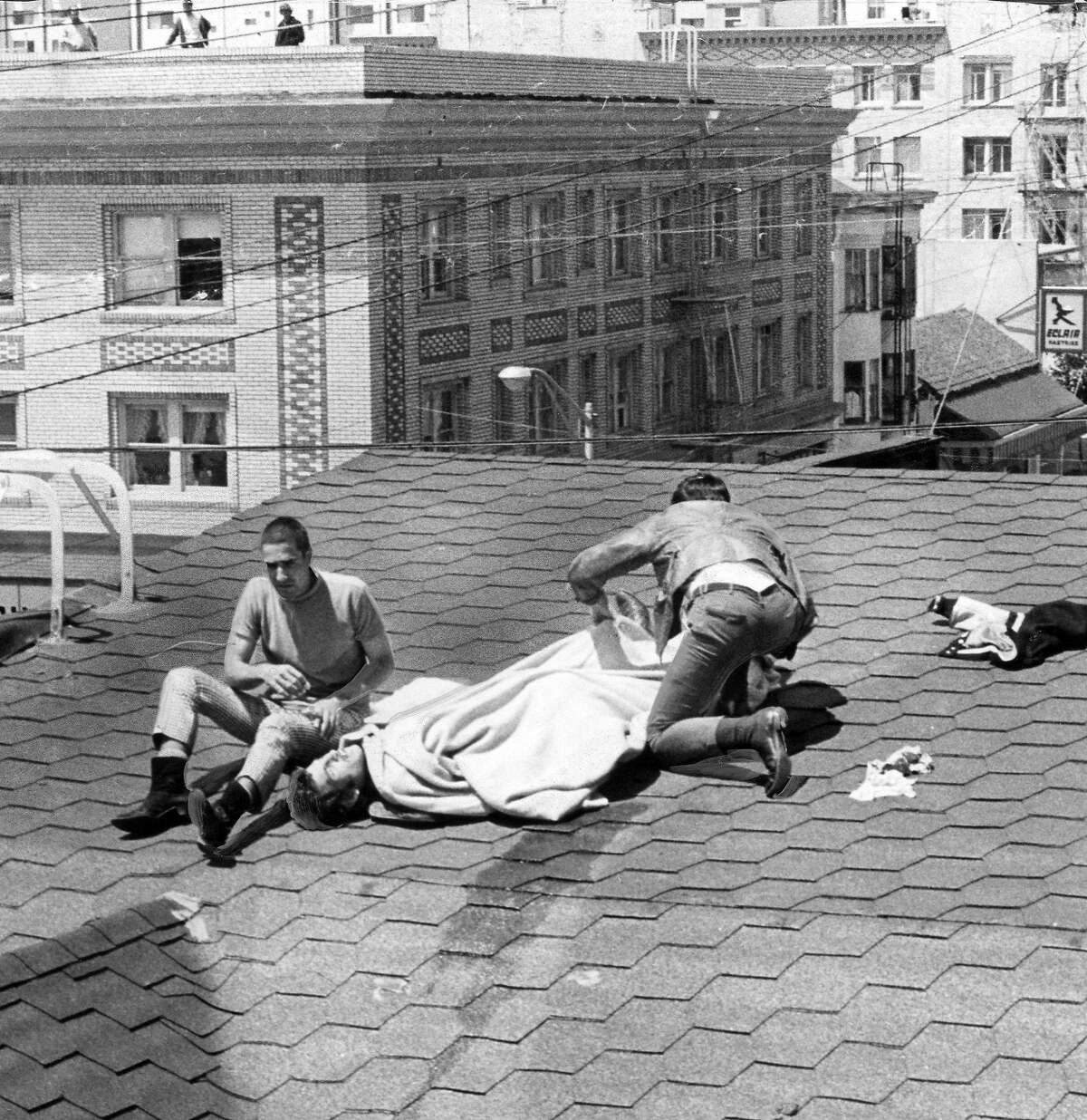 A spectator on the rooftop watching People's Park demonstrators is shot with birdshot in Berkeley May 15, 1969 Photo ran 05/16/1969, p. 6