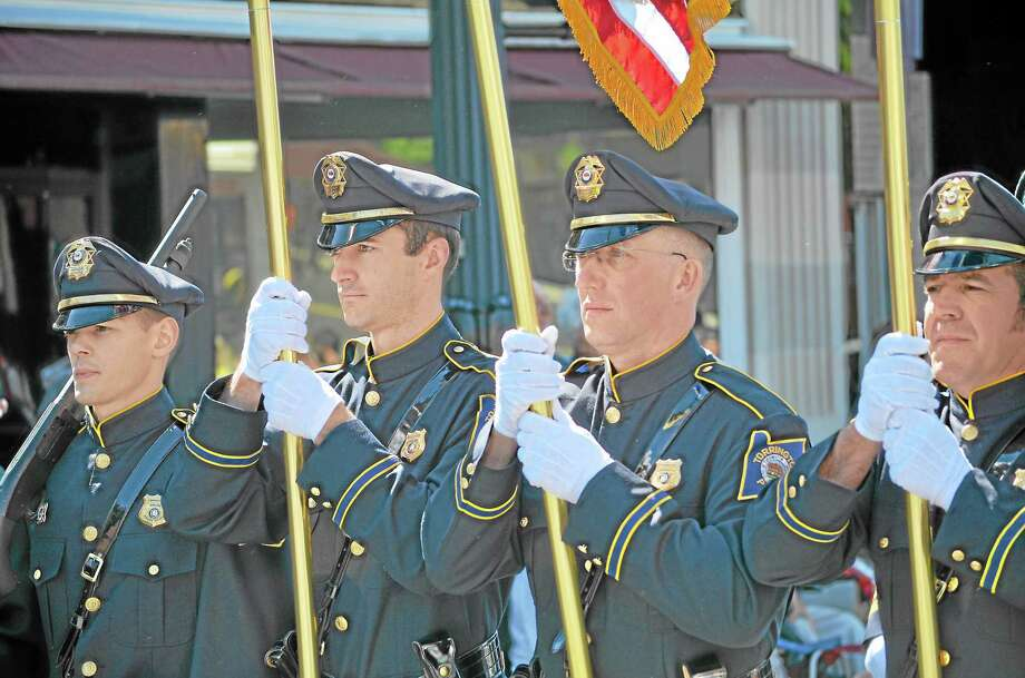 Torrington Police officers march in the city's 2015 Memorial Day Parade. Photo: File Photo / Hearst Connecticut Media