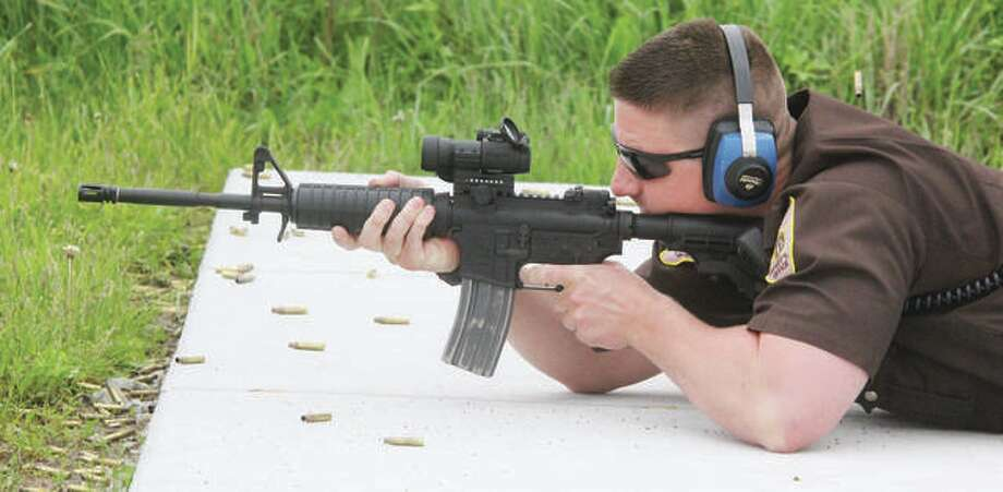 Madison County Sheriff's Deputy Ben Patterson fires an AR-15 at the departments firing range while qualifying with his duty weapons Thursday. Photo: Scott Cousins | Hearst Illinois