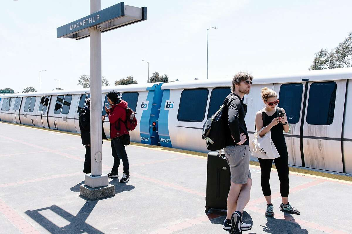 Passengers stand infant of a new BART train at MacArthur Station in Oakland, Calif, on Friday, May 10, 2019.