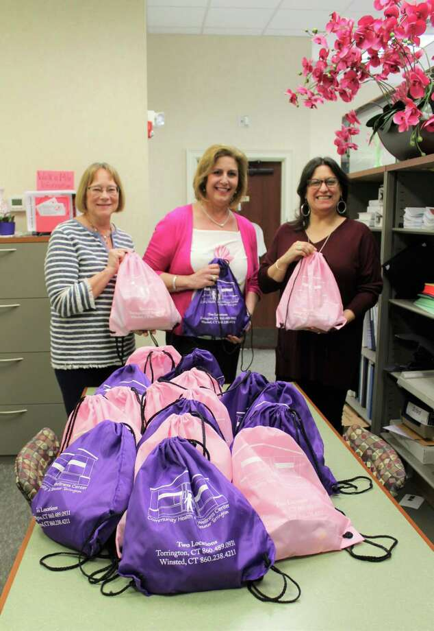 Torrington's Community Health & Wellness Center recently donated 20 beauty bags to the Susan B. Anthony Project in Torrington, which provides assistance and support to adults and children who are victims of domestic violence. Packaged in purple and pink drawstring pouches, the bags contain a variety of beauty and wellness products donated by CHWC staff and Ridge Runner Soap Company of Harwinton. Above, staff members show the completed bags. Photo: Contributed Photo /