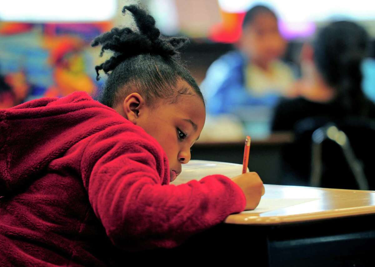 Student Jayla Brown works on an assignment at Hall School on Clermont Ave on the East End in Bridgeport, Conn., on Friday May 10, 2019. Due to a city council decision to underfund the district, this school may face closure.