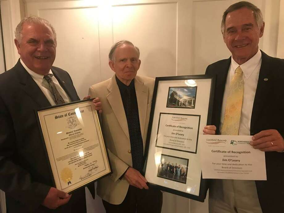 James P. O'Leary was honored as he retired from Litchfield Bancorp's Board of Directors after 28 years in April 2019. At a dinner held at Tavern off the Green in the Litchfield Inn, O'Leary was presented with a plaque of appreciation from Litchfield Bancorp, as well as a citation from the State of Connecticut. From left are Thomas Villanova, O'Leary and Donald Mayland. Photo: Contributed Photo /