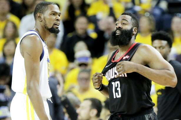 Houston Rockets guard James Harden (13) reacts to getting fouled on a three-point shot by Golden State Warriors forward Kevin Durant (35) during Game 5 of the NBA Western Conference semifinals at Oracle Arena on Wednesday, May 8, 2019, in Oakland.