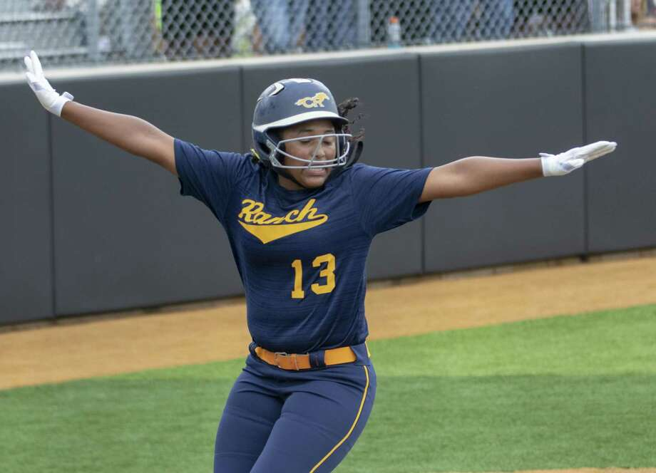 Cypress Ranch Camryn Carmouche (13) spreads her arms after crossing home plate during a Region III-5A quarterfinal softball game at Grand Oaks High School in Spring. Photo: Cody Bahn, Houston Chronicle / Staff Photographer / © 2018 Houston Chronicle