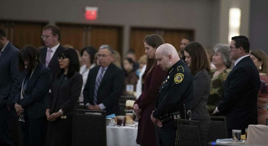 Bexar County Sheriff Javier Salazar and more than 600 guests bow their heads as Marta Pelaez CEO of Family Violence Prevention Services reads the name of 28 women who died this year due to domestic violence during the 18th Annual Honoring Mothers Luncheon May 10 in San Antonio. SAPD has access to a well-rounded program for preventing domestic violence — they should revisit Victim's Advocacy. Photo: /Carlos Javier Sanchez / Contributor / Carlos Javier Sanchez