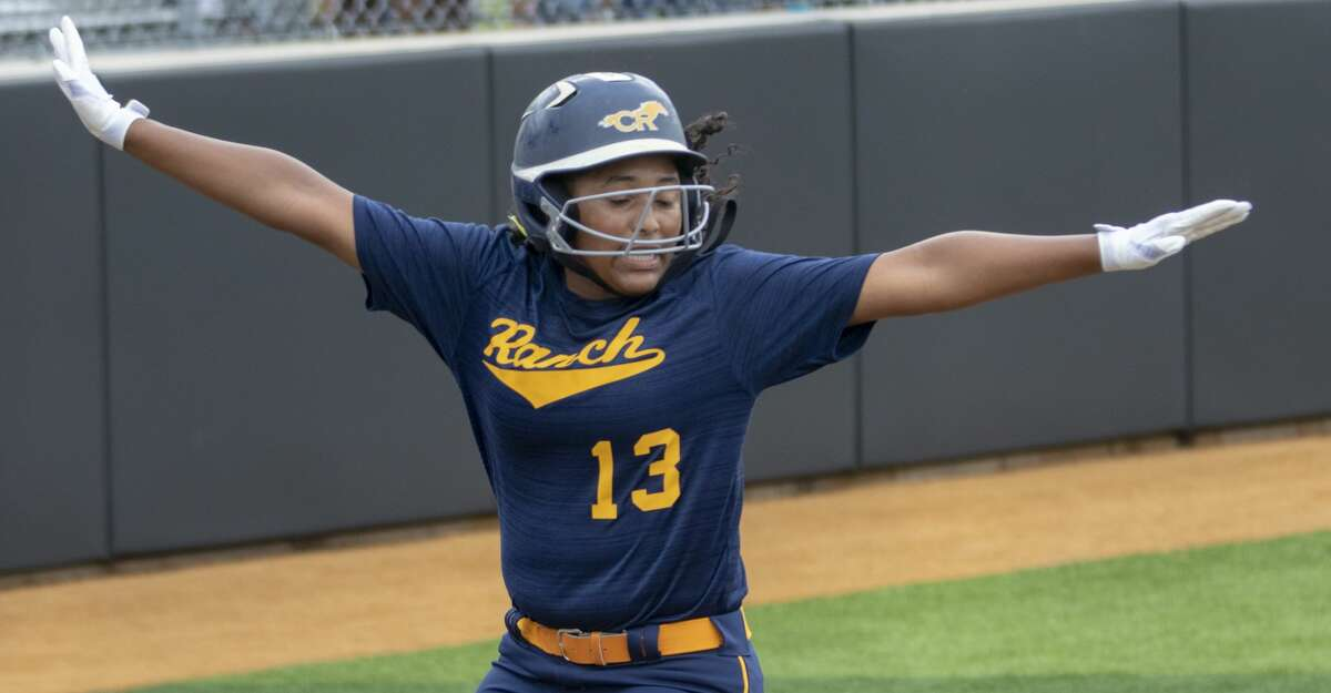 Cypress Ranch Camryn Carmouche (13) spreads her arms after crossing home plate during a Region III-5A quarterfinal softball game at Grand Oaks High School in Spring.