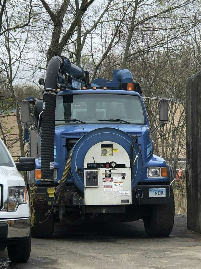 East Haven's vacuum truck to clean debris out of catch basis still sits outside the public works garage on North High Street — for now. Photo: Contributed Photo