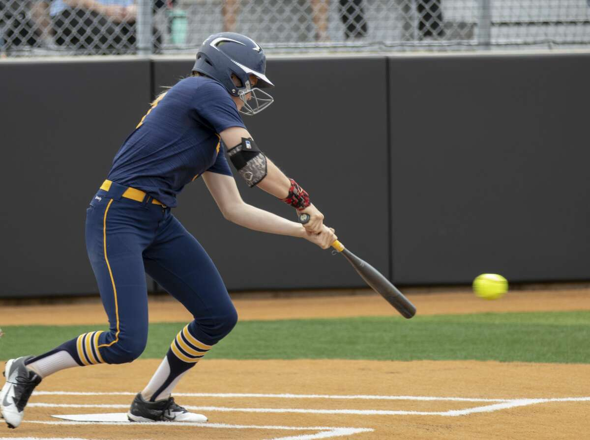Cypress Ranch pitcher Britton Rogers (11) hits a ball during a Region III-5A quarterfinal softball game at Grand Oaks High School in Spring.