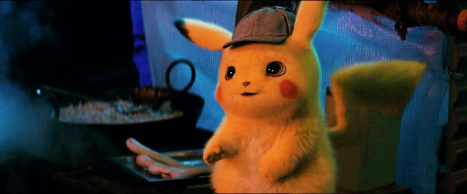 """This image released by Warner Bros. Pictures shows the character Detective Pikachu, voiced by Ryan Reynolds, in a scene from """"Pokemon Detective Pikachu."""" (Warner Bros. Pictures via AP) / © 2018 Warner Bros. Entertainment Inc. All Rights Reserved."""