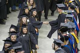 Midland College students process in 05/10/19 evening at the Chaparral Center for the 46th Commencement Ceremony. Tim Fischer/Reporter-Telegram