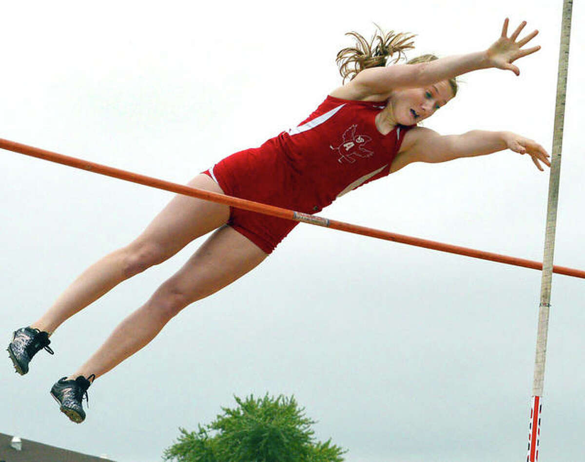 Alton's Lauren Weiner clears the bar during pole vault competiton at Thursday's IHSA Class 3A Track and Field sectional at O'Fallon. Weiner set an Alton High record for the third time this season and qualified for the IHSA Girls State Track and Field Meet set for next week in Charleston.