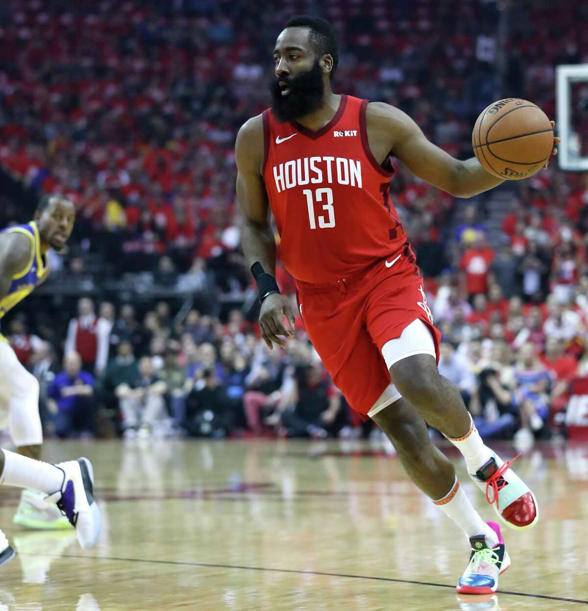 Houston Rockets guard James Harden (13) takes the ball up the court against the Golden State Warriors during the first half of Game 6 of the NBA Western Conference semifinals at Toyota Center on Friday, May 10, 2019, in Houston.