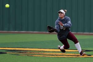 Lee's Litzy Gutierrez (11) scrambles to make a catch against Odessa High May 10, 2019, at the Seminole High School softball field in Seminole. James Durbin/Reporter-Telegram