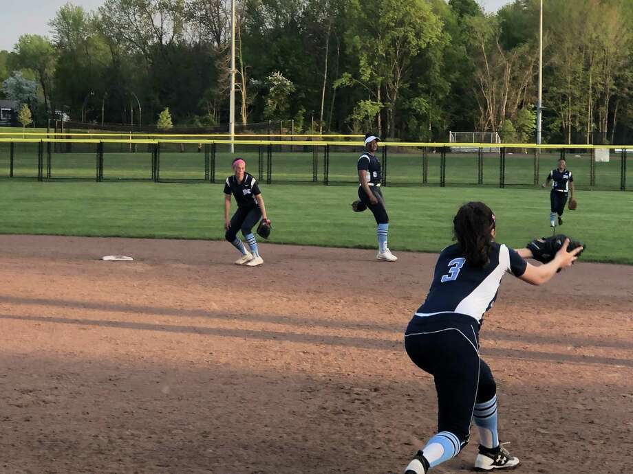 Middletown shortstop Dominique Highsmith, center, throws to first for an out in the fourth inning of Friday's game against Windsor. Windsor won, 7-5. Photo: Paul Augeri / Hearst Connecticut Media