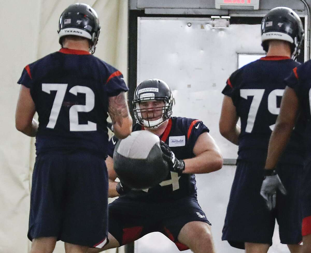 Houston Texans tackle Max Scharping throws a medicine ball to tackle Rick Leonard during rookie mini camp at The Methodist Training Center on Friday, May 10, 2019, in Houston.