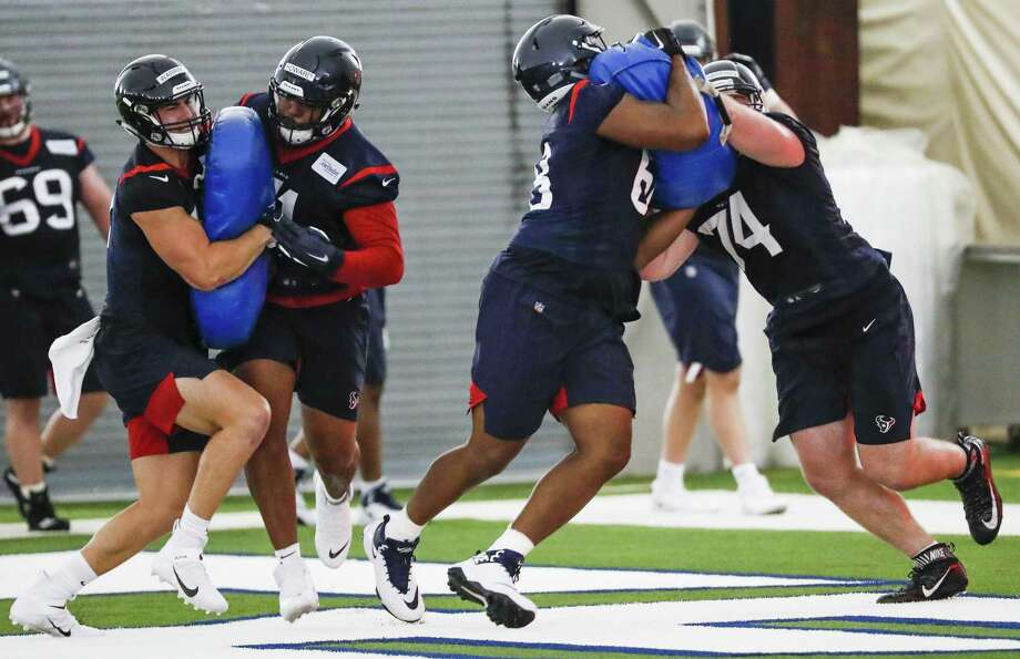 PHOTOS: Texans vs. Falcons  Houston Texans tackles Tytus Howard (71) and Max Scharping (74), run a blocking drill during rookie mini camp at The Methodist Training Center on Friday, May 10, 2019, in Houston. >>>See more photos from the Texans' win against the Falcons on Sunday ...  Photo: Brett Coomer, Houston Chronicle / Staff Photographer / © 2019 Houston Chronicle
