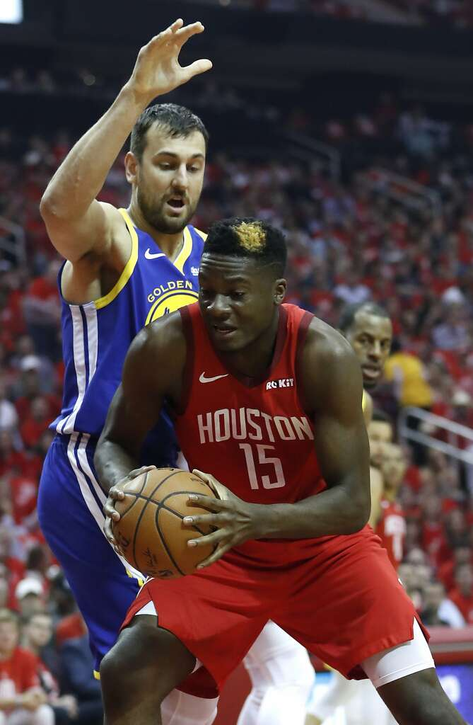 58189181f6eb Houston Rockets center Clint Capela (15) works to the basket against Golden  State Warriors