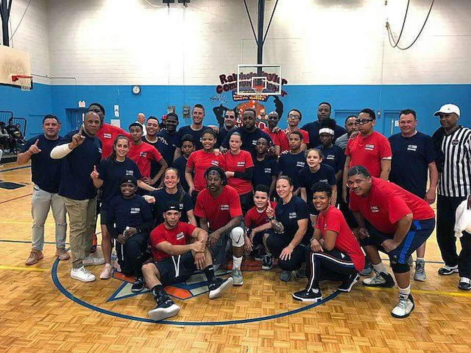 Bridgeport, Conn., police geared up along with some city youth to play basketball on May 10, 2019. Photo: Contributed Photo