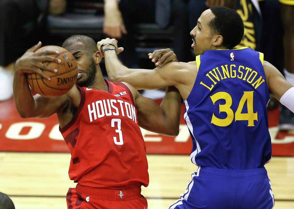Houston Rockets guard Chris Paul (3) grabs a rebound away from Golden State Warriors guard Shaun Livingston (34) during the first half of Game 6 of the NBA Western Conference semifinals at Toyota Center on Friday, May 10, 2019, in Houston.