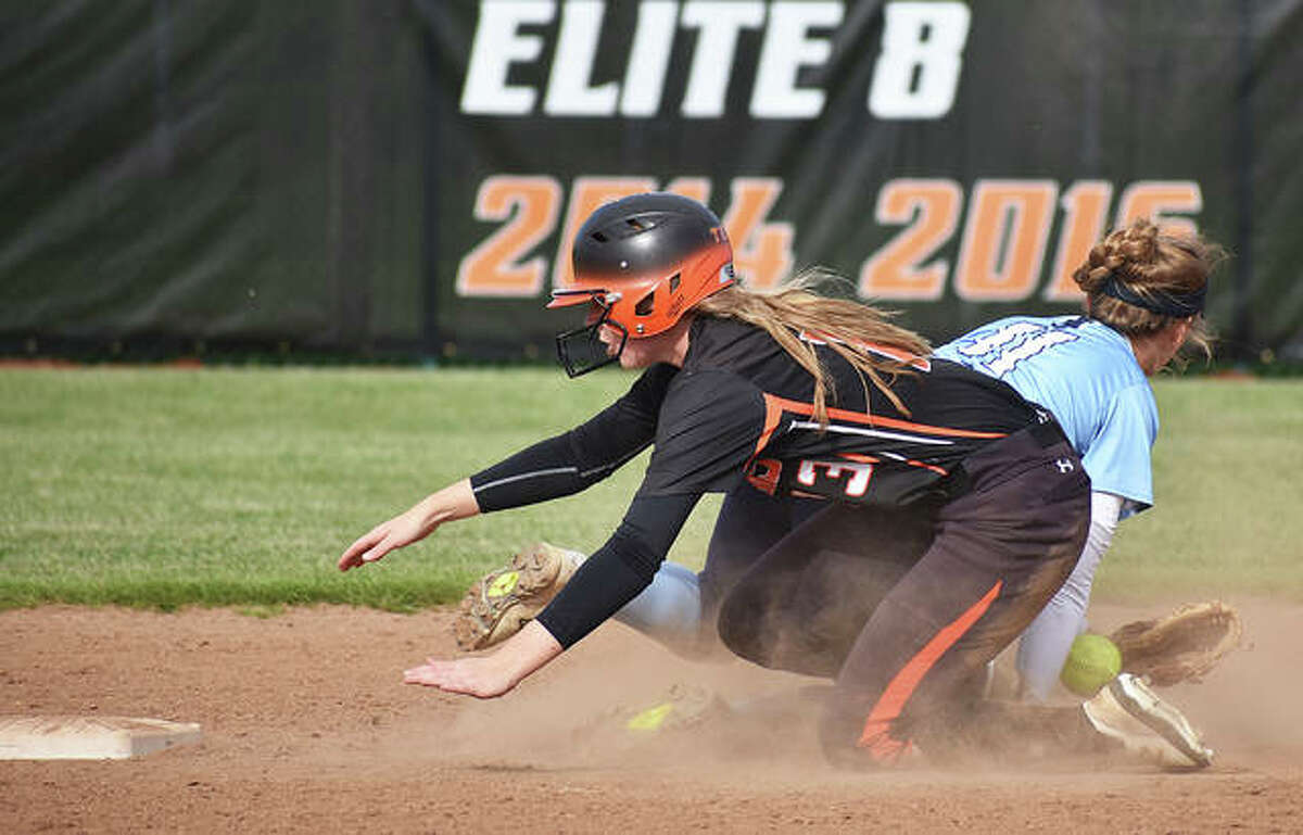 Edwardsville's Katherine Bobinski-Boyd reaches for second base to complete a stolen base in the fifth inning of Friday's 3-0 softball victory over Jersey.