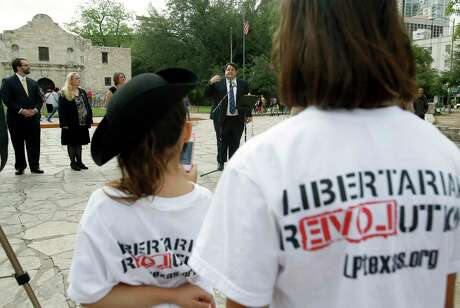 Libertarian party candidate for Texas lieutenant governor Robert Butler, at microphone, speaks Thursday May 1, 2014 in front of the Alamo about his election platform during a news conference for Libertarian party candidates seeking statewide office.