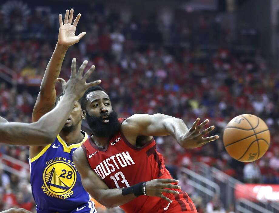 962fe1cb2f25 Houston Rockets guard James Harden (13) passes the ball out of the lane  against