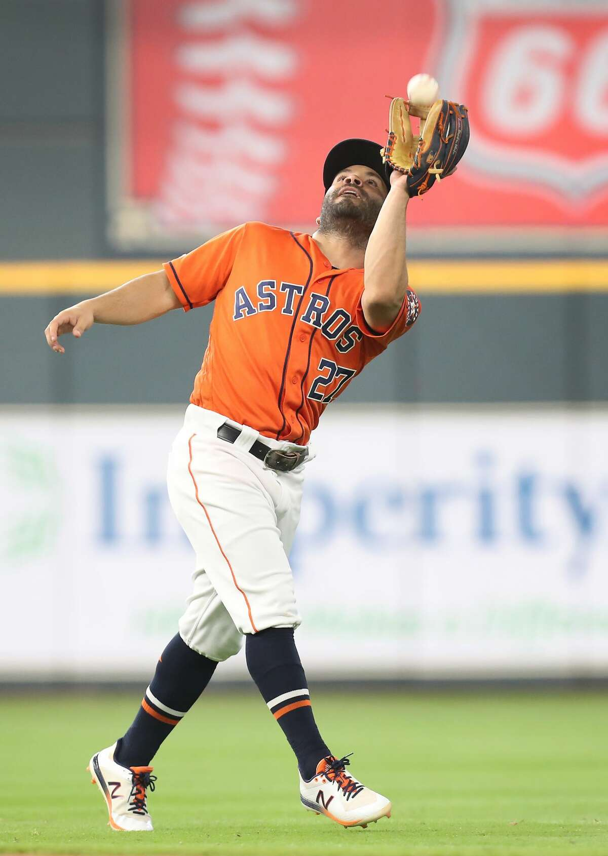 Houston Astros second baseman Jose Altuve (27) catches a pop up by Texas Rangers shortstop Elvis Andrus (1) during the first-inning of an MLB baseball game at Minute Maid Park Friday, May 10, 2019, in Houston.