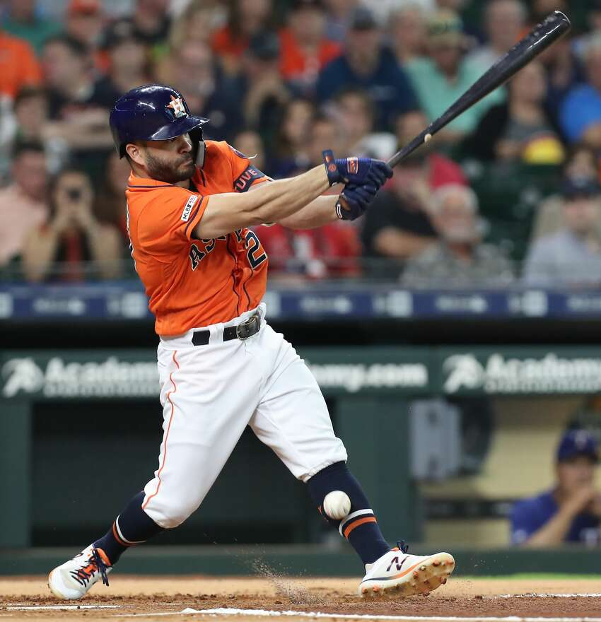 Houston Astros second baseman Jose Altuve (27) is hit in his left leg with a foul ball during the first inning of an MLB baseball game at Minute Maid Park Friday, May 10, 2019, in Houston.