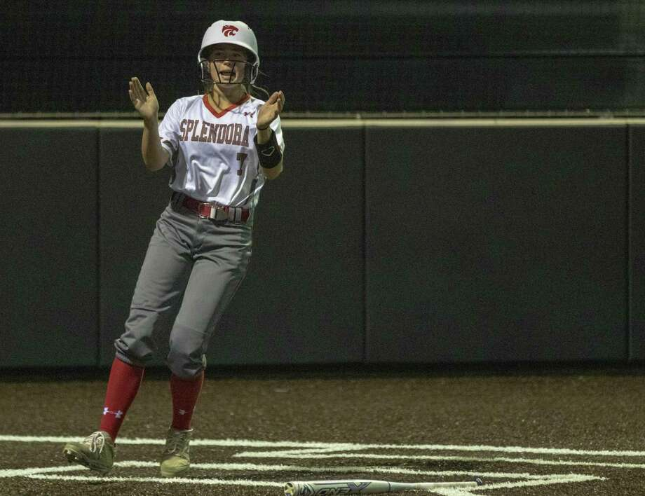 Splendora courtesy runner Honor Knott (7) claps her hands after crossing home plate during a Region III-4A quarterfinal softball game at Humble High School in Humble. Photo: Cody Bahn, Houston Chronicle / Staff Photographer / © 2018 Houston Chronicle