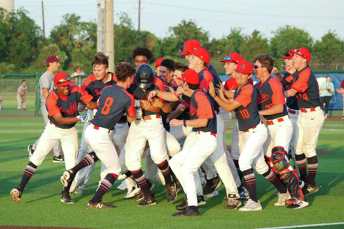 Teammates swarm Atascocita's Caleb Cannon (17) after Cannon knocked in the winning run against Pearland Friday, May 10 at Barbers Hill High School.