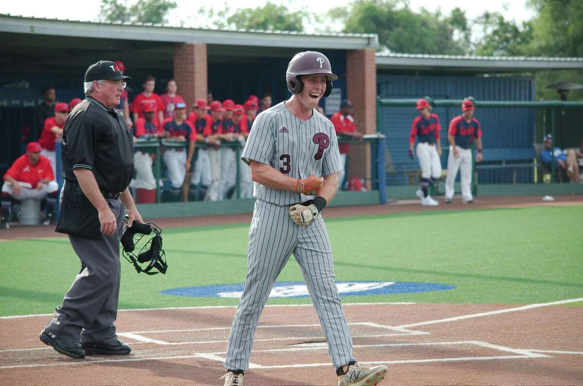 Pearland's Mason Lytle (3) celebrates after scoring a run against Atascocita Friday at Barbers Hill High School.