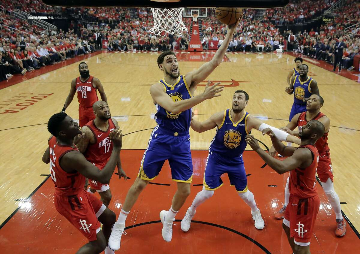 Golden State Warriors guard Klay Thompson (11) goes up for a shot as Andrew Bogut (12) and Houston Rockets' Austin Rivers (25), PJ Tucker (17) and Chris Paul, right front, watch during the first half in Game 6 of a second-round NBA basketball playoff series, Friday, May 10, 2019, in Houston. (AP Photo/Eric Gay)