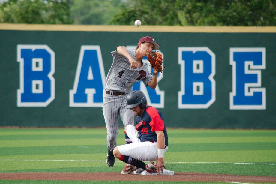 Atascocita's DJ Taylor (19) slides into second base as Pearland's Matthew Shepherd (4) throws to first for the double play Friday, May 10 at Barbers Hill High School. Photo: Kirk Sides/Staff Photographer
