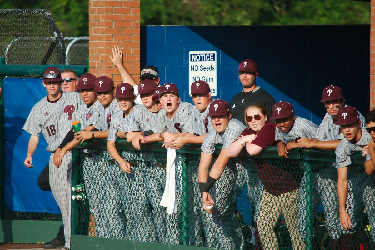 Pearland shows spirit in the dugout against Atascocita Friday, May 10 at Barbers Hill High School.