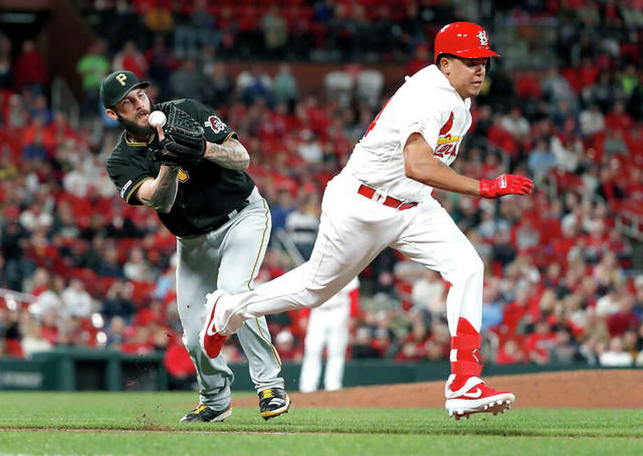 Pirates starting pitcher Trevor Williams, left, bobbles a grounder by the Cardinals' Yairo Munoz as Munoz reaches base safely on a single in the seventh inning of Friday's game in St. Louis. Photo: AP Photo