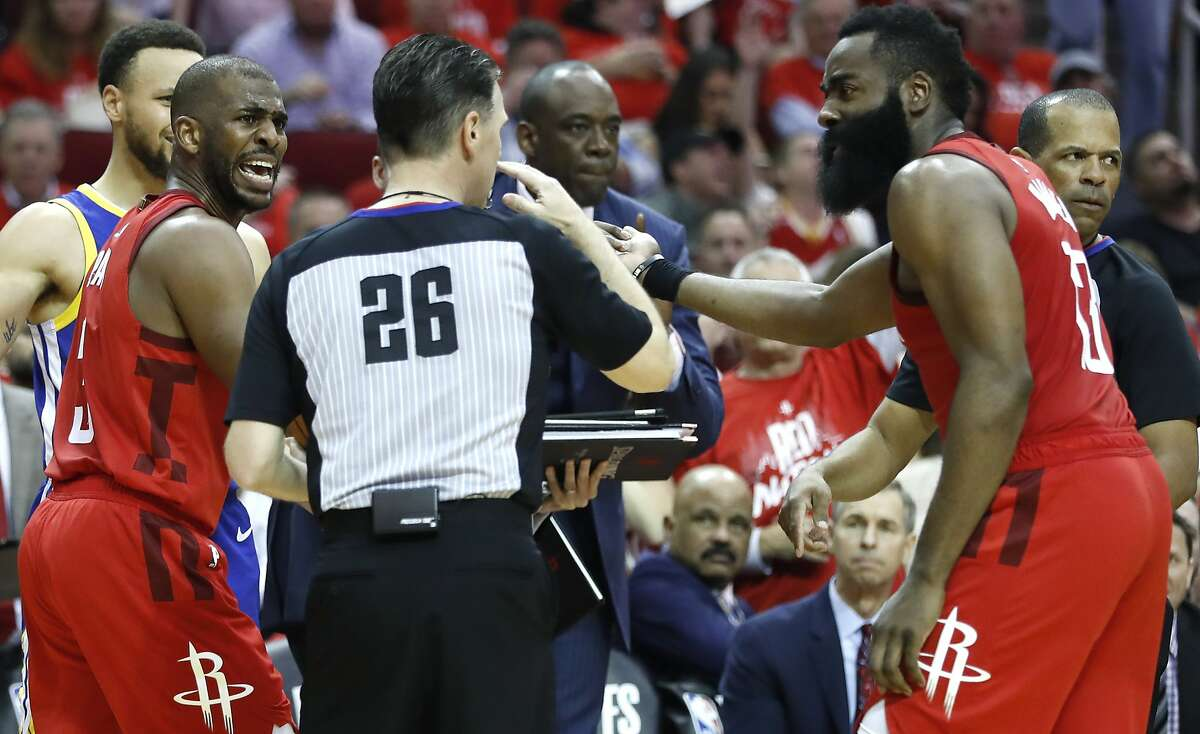 Houston Rockets guards Chris Paul (3) and James Harden (13) argue a call with referee Pat Fraher (26) during the second half of Game 6 of the NBA Western Conference semifinals against the Golden State Warriors at Toyota Center on Friday, May 10, 2019, in Houston.