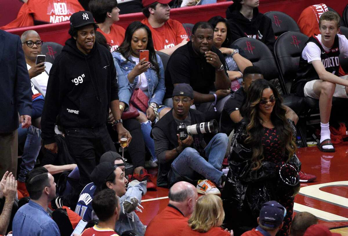 Celebrities at Game 6 of Rockets-Warriors series Jay-Z, left, and Beyonce walk onto the court during the second half of Game 6 of a second-round NBA basketball playoff series between the Golden State Warriors and Houston Rockets on Friday, May 10, 2019, in Houston. (AP Photo/Eric Christian Smith)