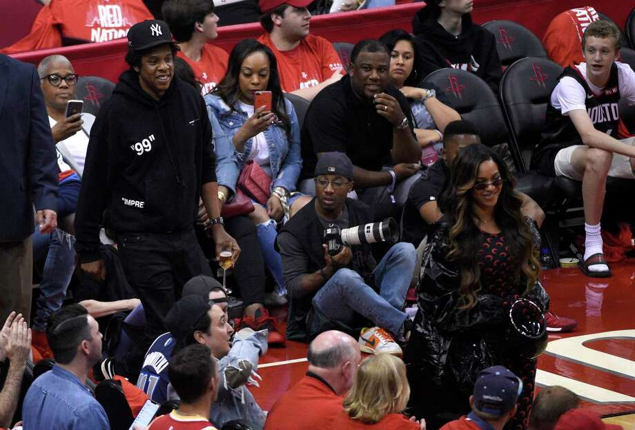 Jay-Z, left, and Beyonce walk onto the court during the second half of Game 6 of a second-round NBA basketball playoff series between the Golden State Warriors and Houston Rockets on Friday, May 10, 2019, in Houston. (AP Photo/Eric Christian Smith) Photo: Eric Christian Smith, Associated Press / Copyright 2019 The Associated Press. All rights reserved.