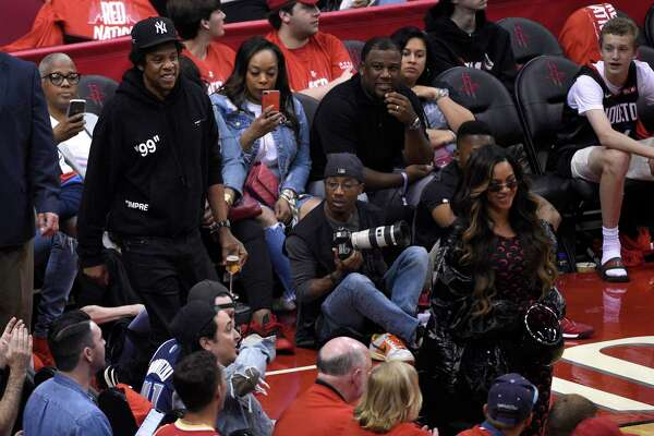 Jay-Z, left, and Beyonce walk onto the court during the second half of Game 6 of a second-round NBA basketball playoff series between the Golden State Warriors and Houston Rockets on Friday, May 10, 2019, in Houston. (AP Photo/Eric Christian Smith)
