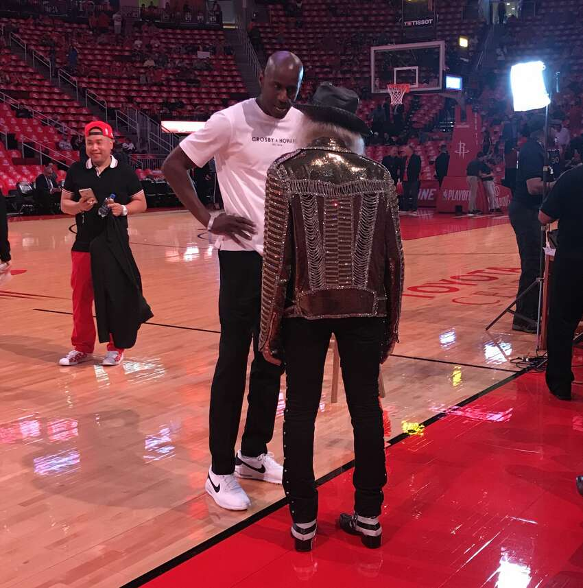 Former Rockets guard Vernon Maxwell chats with NBA superfan Jimmy Goldstein before Game 6 of the Rockets-Warriors series on Friday, May 10, 2019.