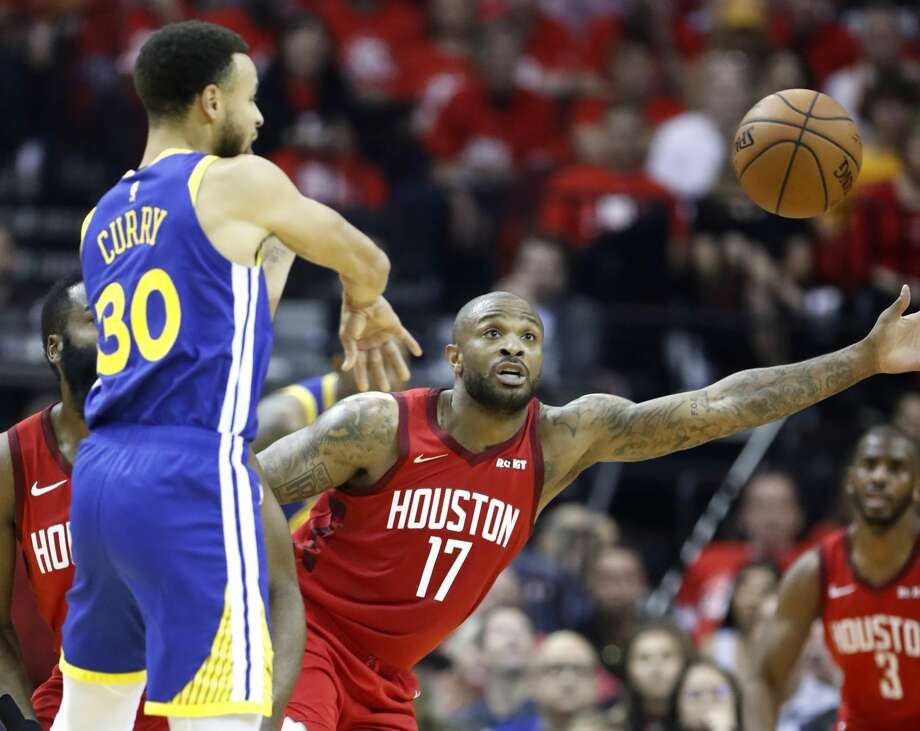 Houston Rockets forward PJ Tucker (17) reaches out to defend a pass by Golden State Warriors guard Stephen Curry (30) during the first half of Game 6 of the NBA Western Conference semifinals at Toyota Center on Friday, May 10, 2019, in Houston. Photo: Karen Warren/Staff Photographer
