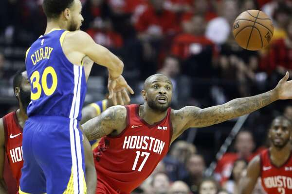 Houston Rockets forward PJ Tucker (17) reaches out to defend a pass by Golden State Warriors guard Stephen Curry (30) during the first half of Game 6 of the NBA Western Conference semifinals at Toyota Center on Friday, May 10, 2019, in Houston.