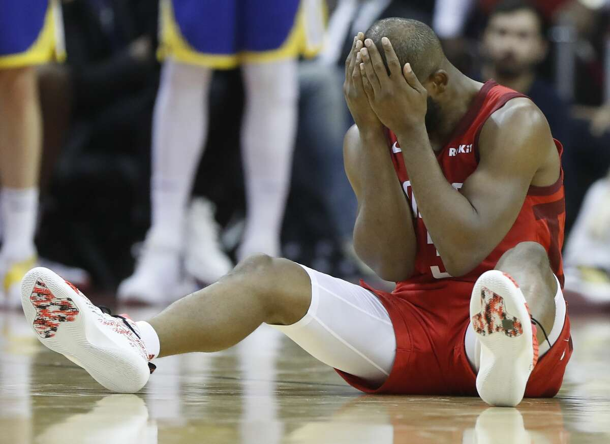 Rockets guard Chris Paul (3) holds his face as he sits on the floor during the second half of Game 6 of the NBA Western Conference semifinals against the Golden State Warriors at Toyota Center on Friday, May 10, 2019, in Houston.